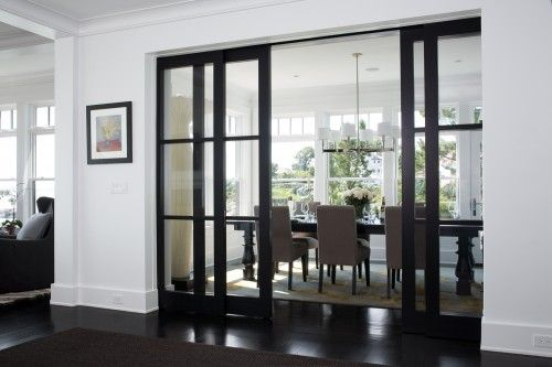 Glass Doors into dining room - nice way to keep everything light and airy but at the same time having a separate space when required