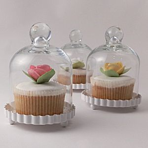 Miniature Glass Bell Jar for wedding cupcakes - from http://www.uniqueweddingfavours.co.uk/weddingfavours/glass-cupcake-bell-jar-642.html#