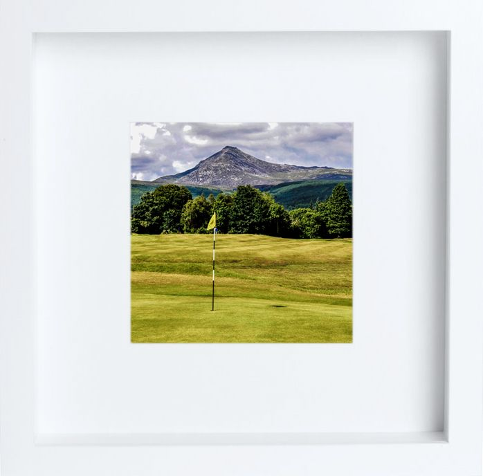 From the limited edition Scotland in Miniature collection.  The isle of Arran nestles approximately 17 miles off the west coast of Scotland and slightly south of the city of Glasgow.  Some have referred to it as Scotland in miniature which is the title of these 10cm square white framed editions revealing a glimpse of it's landscape and it's wildlife. Packed with charm and character Arran is a visual feast for golfers, sailors, walkers, climbers and artists.
