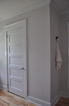 Replace trim and doors with white. Add moulding to top of doors to add height and drama.
