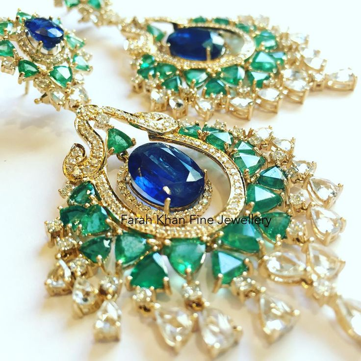 """Our classic favourite peacock emerald diamond earrings by @farahkhanfinejewellery"