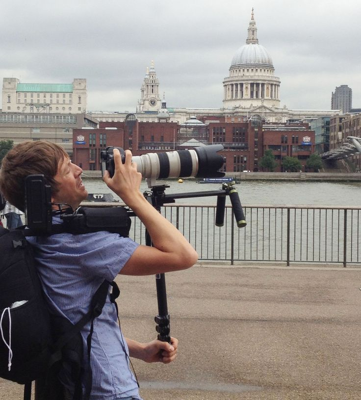 Our camera man getting a shot of our model on London's Millennium (or Wobbly!) bridge! You can see St Paul's in background #Gneo