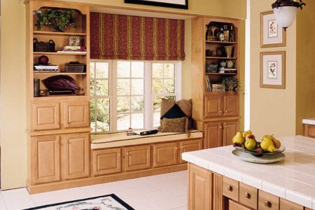 How to build a window seat using kitchen cabinets for Ready built cupboards