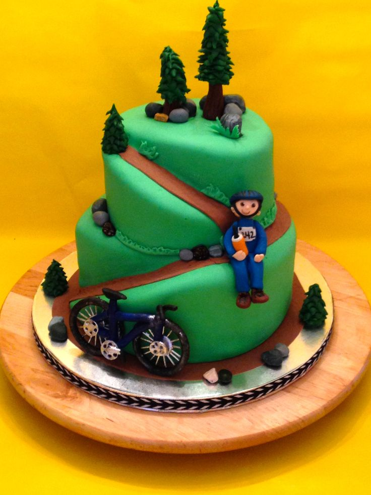 Cakes by Kirsten.  Mountain bike cake.  Chocolate cake with Godiva truffle filling. Hand made sugar details.  #mountain bike cake.  #bike cake.  #outdoor theme cake