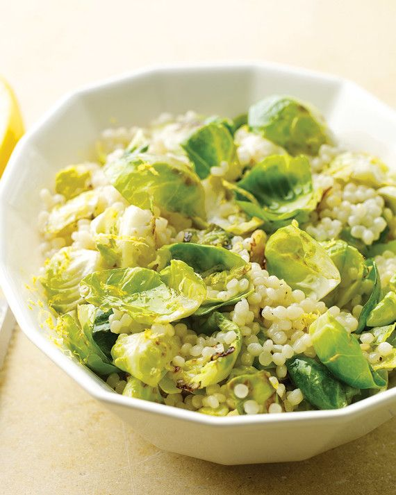 Mixed with a confetti of browned brussels sprout leaves and tangy lemon zest, Israeli couscous makes a colorful side dish.