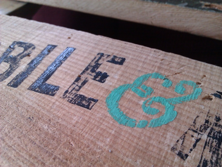 Mobile + Mint identity. Hand cut lino stamp on East London Furniture crate