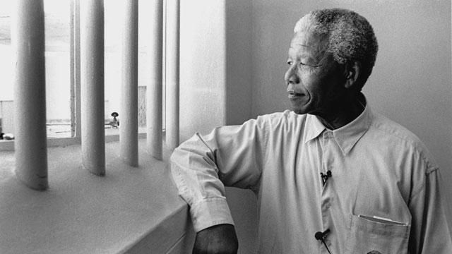 Nelson Mandela revisits his prison cell on Robben Island in 1994, where he had spent 18 of his 27 years in prison.