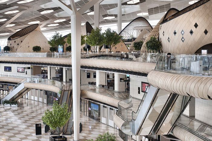 """Turkish architecture studio Autoban has designed an """"organic"""" airport terminal, featuring wooden cocoons, living trees and hexagonal skylights. The soothing and innovative design is the newest addition to Azerbaijan's Baku Airport."""