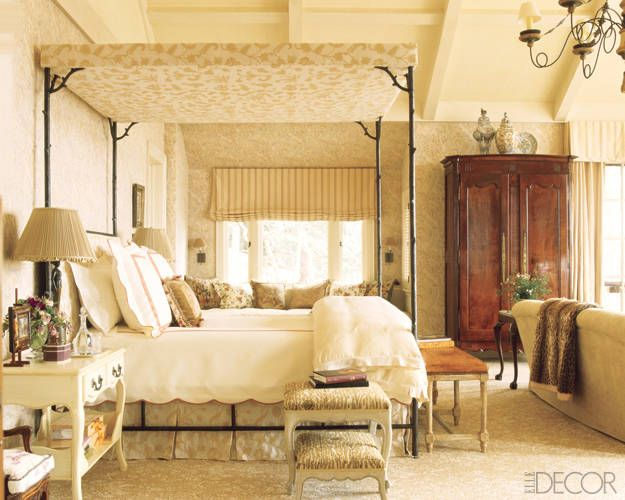 Charlotte Moss Ski House Decor - Ski Retreat Interior Design - ELLE DECOR - Charlotte's master bedroom with canopy bed styled after one by Pauline de Rothschild with linen covered wall.s