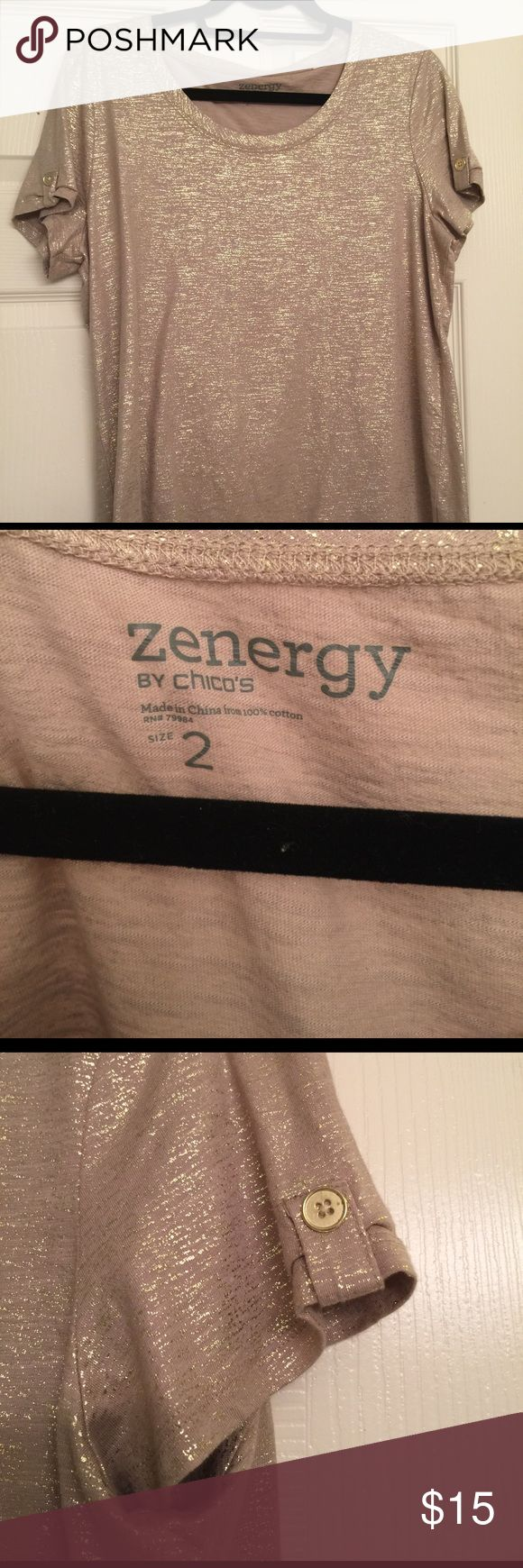 Zenergy by Chico's Gold T Shirt This is new without tags t shirt. It is labeled a size 2 in Chico's sizes, which I think equates to a 10. It has small gold button tab details in the sleeves and is 100% cotton. Gorgeous color. It was a gift but it is a bit too big on me. I am a size 8 and I think it is more a size 10. Chico's Tops Tees - Short Sleeve