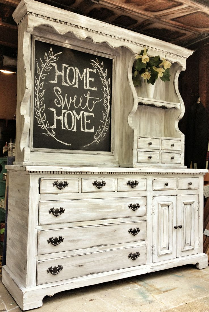 This is an old pine hutch that once had a mirror. We painted it in a driftwood style by dry brushing taupe and white over gray.