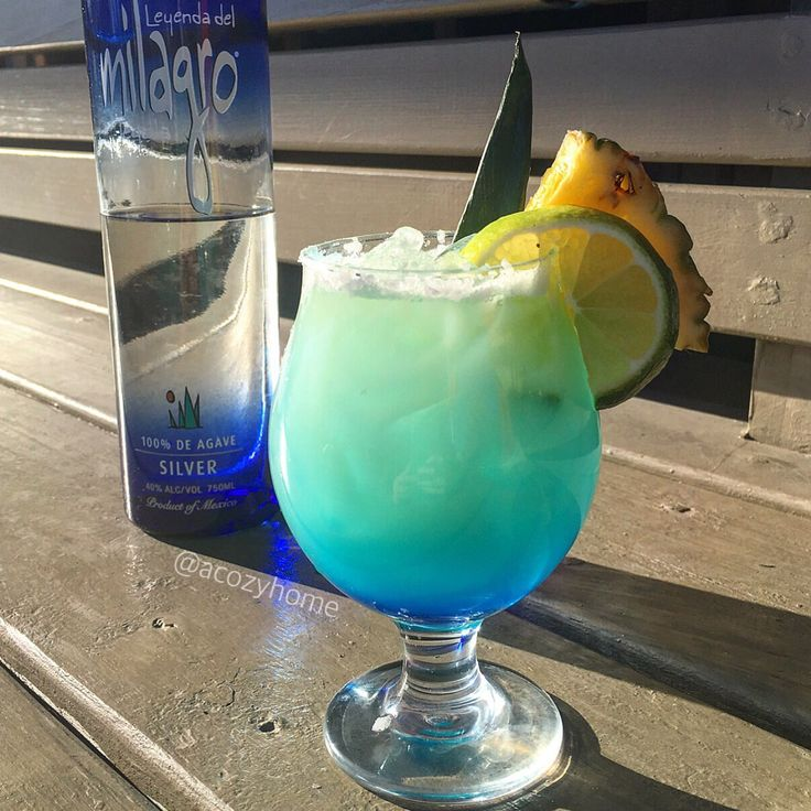 Blue Island Margarita 2 oz Milagro Tequila 1 oz Triple Sec 1 oz Pineapple Juice 1 oz Monin Coconut Pureè Splash of Lime Juice Shake & Pour over ice Sink Blue Curaçao in bottom of glass