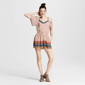 Stay cool and comfortable in the Women's Button-front Romper by Xhilaration (Juniors'). Festival season is here and this juniors' romper is a perfect choice for your next musical adventure. Wear it with your jean jacket and favorite pair of sunnies to create a laid-back, boho vibe<br><br>Used to Women's sizes? Size up in Junior's or check the size chart to determine best fit.