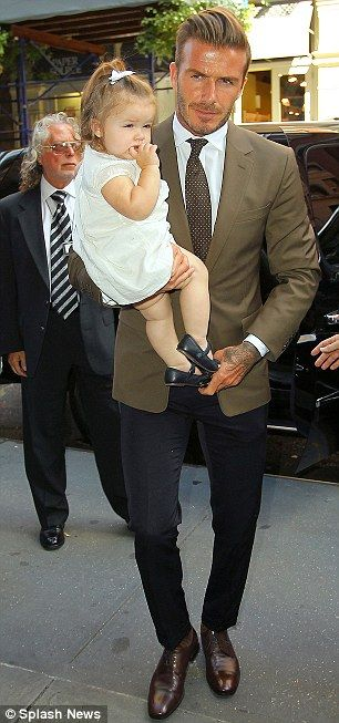 Angelic: While David looked as dapper as ever in his olive jacket and black trousers, Harper looked adorable in a white dress and black shoes