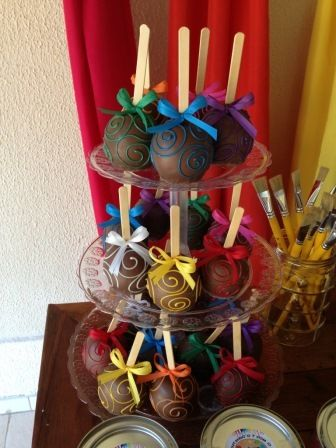 Multi colored chocolate covered caramel apples at an Art Party #artparty #candyapples
