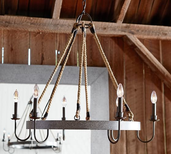 A rustic iron barrel hoop hangs from six thick rope cords bringing wine country style to your dining room