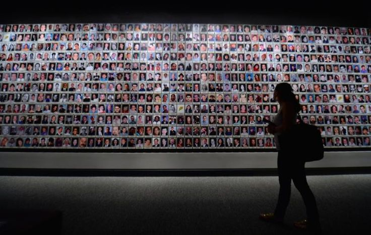 THE VICTIMS OF 911 WTC - THE MEMORIUM WALL AT THE 911 WTC MUSEUM