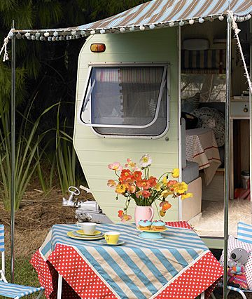 Adorable camper, lovely table and chairs.