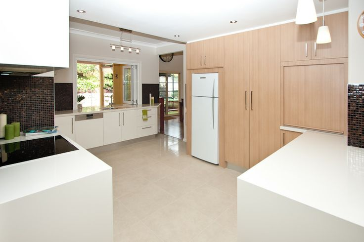 A predominantly light kitchen creates a wonderful feeling of space. www.onecallkitchens.com.au