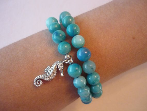 Aqua shell beads in a double strand bracelet with a seahorse charm