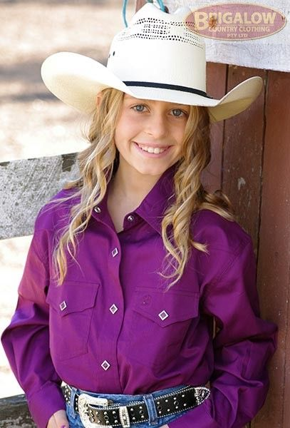 Girls Long Sleeve Shirt Snap Close Shirts | Brigalow Country ClothingThese are our flagship shirts here at Brigalow, part of our staple stock line that our customers love. Made from 100% Cotton these shirts are built tough to last longer. Cut with the horse rider in mind these shirts feature longer sleeves, adjustable cuffs, and a long shirt tail.