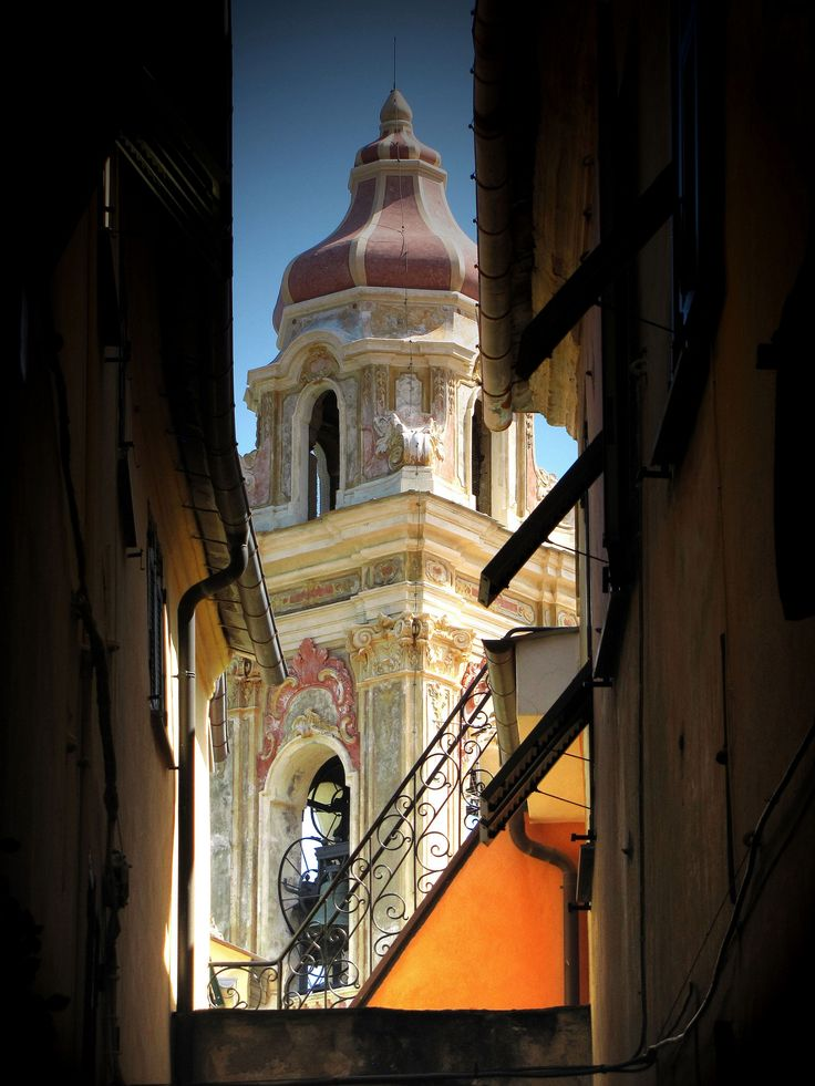 "The bell tower of the majestic church of Cervo. This lovely and ancient coastal village is located along the Italian Western Riviera, just 20 min drive from ""La Meridiana"" in Garlenda."