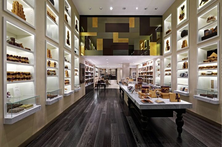 Glowing lights and built in shelves, high storage.  GODIVA concept design by d ash design.