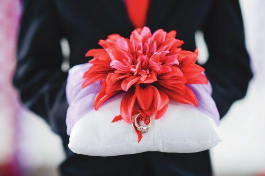 Red dahlia on ring bearer pillow @racarp