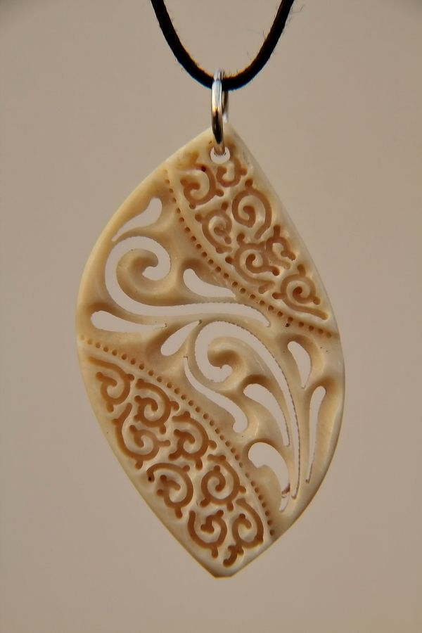 Could do this out of polymer clay - make a texture for the middle and after baking crave into it until there are holes.