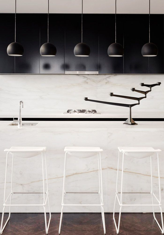 White and black kitchen with marble details