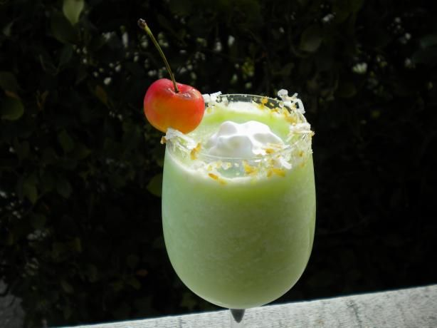 Midori Pina Colada: 2 ounces Midori melon liqueur,  2 ounces coconut milk,  1 ounce coconut rum,  4 ounces pineapple juice,  ice and maraschino cherry.   Directions:  In a blender, combine ingredients (except cherry) with ice until well blended. Pour into tall glass and garnish with cherry.