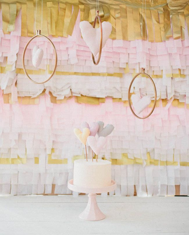 pink and gold fringe backdrop for the dessert table