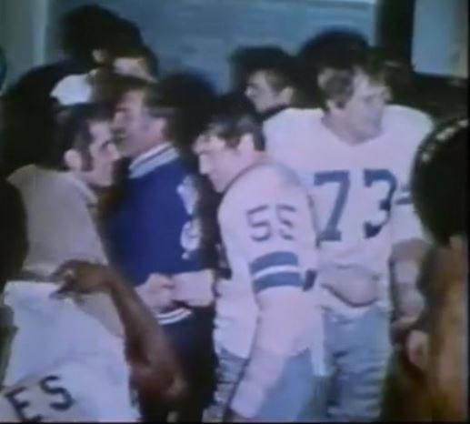Post-game celebration: middle linebacker LEE ROY JORDAN (55) and tackle RALPH NEELY (73) with assistant coach ERNIE STAUTNER--January 3, 1971