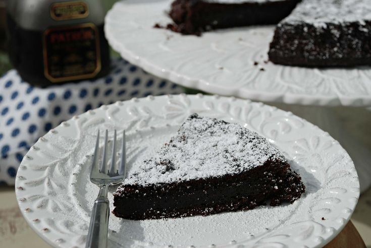 """A decadent chocolate cake spiked with coffee-flavored tequila! This """"Patron Chocolate Coffee Tequila Cake"""" will be a hit at parties."""