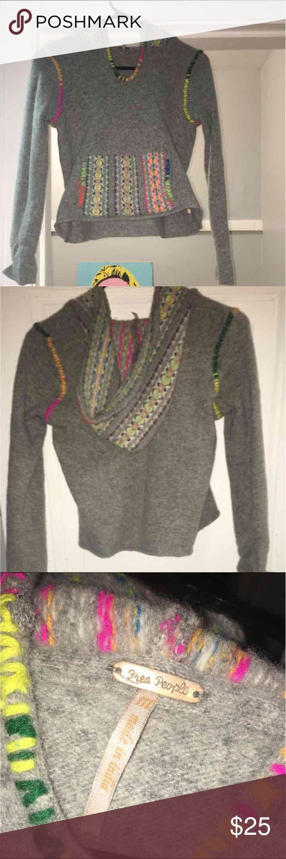 Free People wool pullover Super cute, wool hoodie/pullover. The color is a light gray with a LOT of neon colors!! It SAYS medium but the size fits a S but would much better fit an XS. perfect for cool summer nights 😎 Free People Sweaters