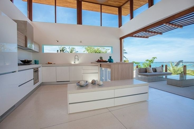 Let the inside go out with this open plan kitchen leading onto the deck with it's magnificent view. #white #kitchen #australian