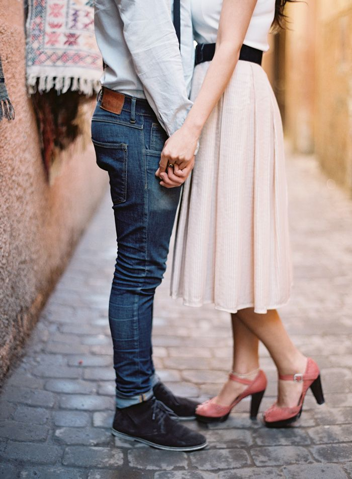 Simplicity is key. Jeans for him. Skirt & cute shoes for her. Lovely.  Morocco Engagement by Jose Villa