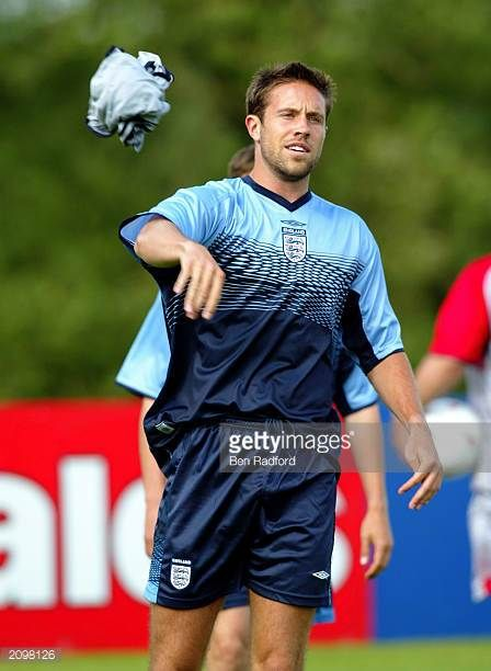 Matthew Upson of England throws his top over during the England Training Session held on June 2 2003 at the Champney's Springs Hydro in Ashby De La...