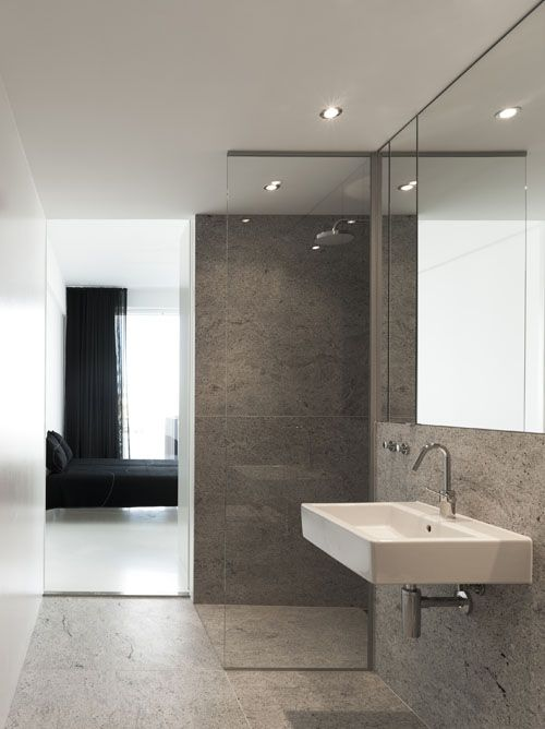 SImple but beautiful bathroom made from travertine. Stay hotel in Copenhagen.