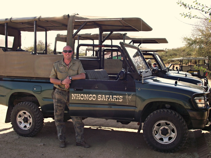 Open Safari Vehicles standing at Skukuza Daty Visitors with head guide Mark.