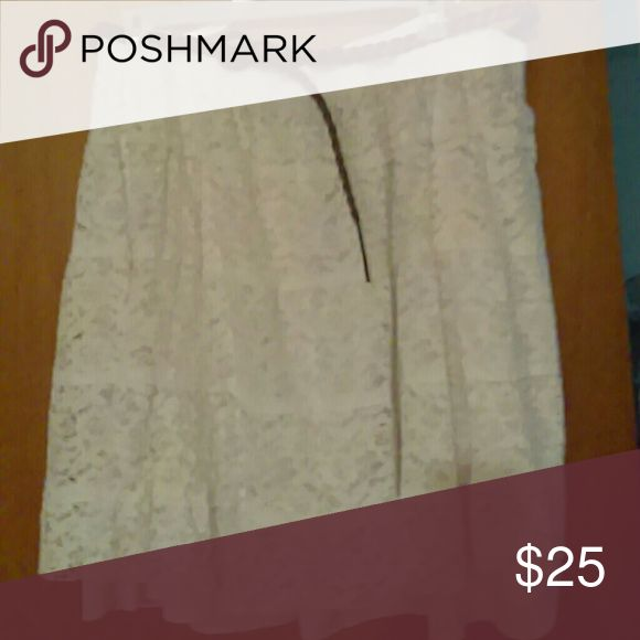 Dressy skirt White lace with a little satin hanging just below hem. Comes with brow braided belt. Looks great with dressy shoes or cowgirl boots. It is not a stain on skirt, it is a shadow Dress Barn Skirts Asymmetrical