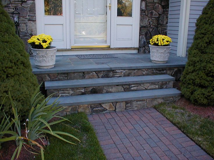 Add bluestone to front step treads someday.