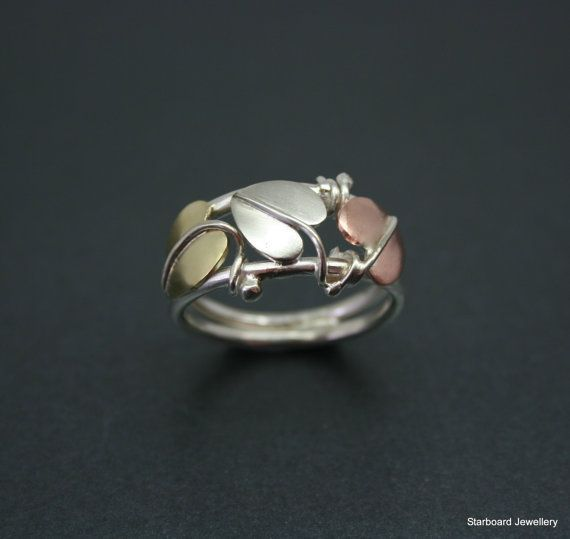 Silver copper and brass three leaf ring by starboardjewellery