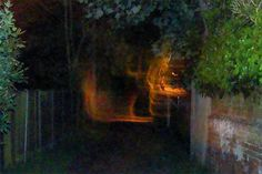 A retired policeman claims to have captured a picture of ghosts carrying the body of a witch on a stretcher. Chris Halton, 55, took the eery photo on Coffin Alley while visiting The Cage, in St Osyth village, Essex – dubbed one of Britain's most haunted houses, according to TV series Great British Ghosts.