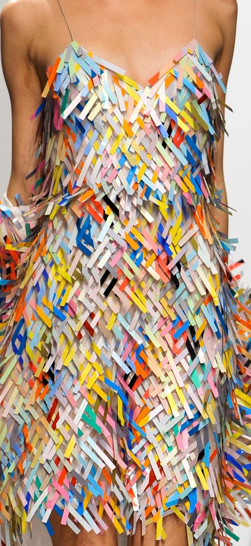 http://www.trendzystreet.com/clothing/dresses - Chalayan - Spring 2014. Yep, it's paper. Don't know how many times it could be worn, or if you could sit down in it. But it's really colorful and cute!