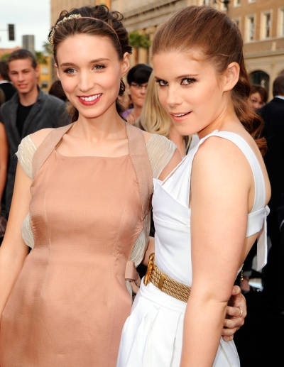 The Mara sisters get their hair of their face with a messy updo and sleek pony tail.