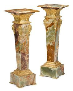 Pair of onyx and gilt bronze mounted pedestals …