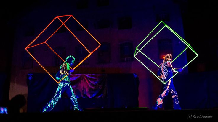 Acrobats and UV dancers with juggling cubes in black light show Anta Agni http://antaagni.com/uv-light-show/