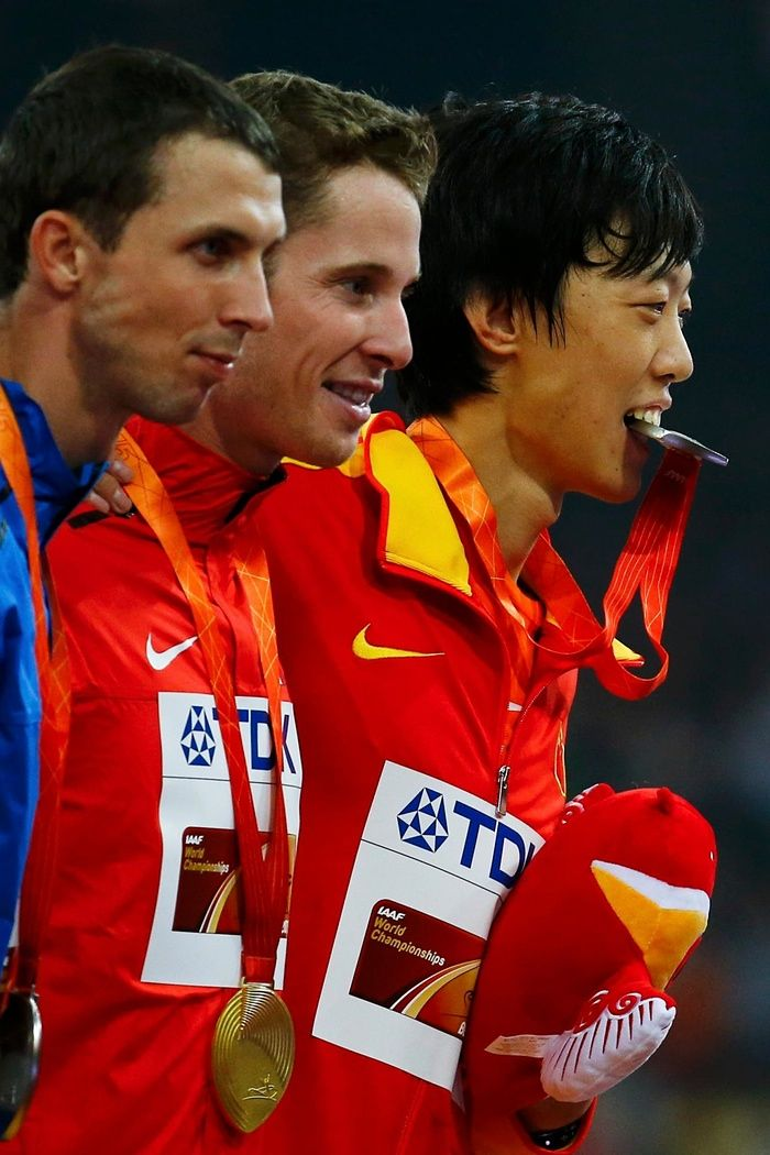 World Athletics Championships 2015: day nine – in pictures | Sport | Canada's Derek Drouin, centre, the gold medallist in the men's high jump, is flanked by the bronze medalist Bohdan Bondarenko of Ukraine and, right, China's Guowei Zhang, seen here chewing his silver medal