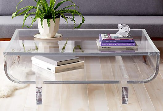 Freaking out over this lucite coffee table